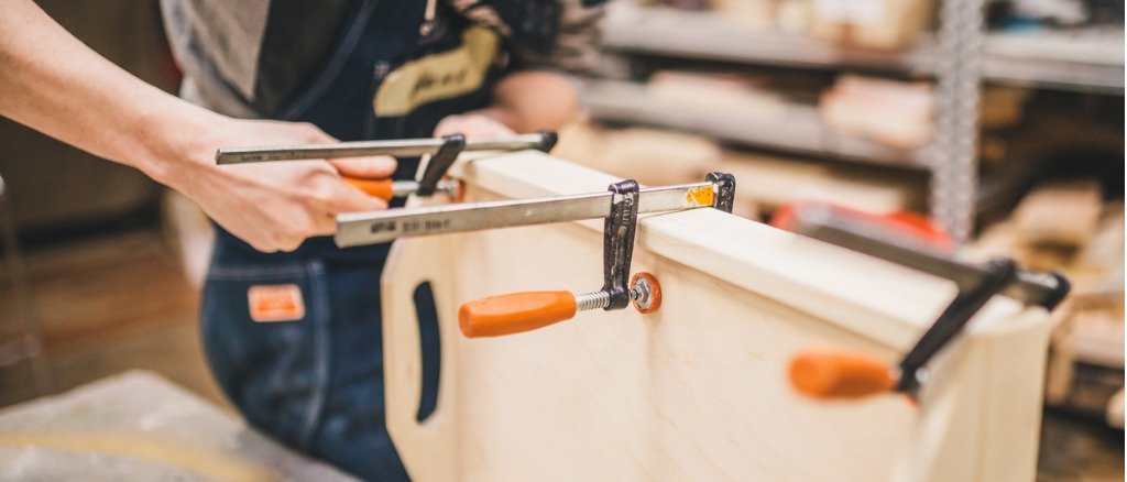 carpentry-workshop-work-with-clamps-fixing-picture-id1195446526