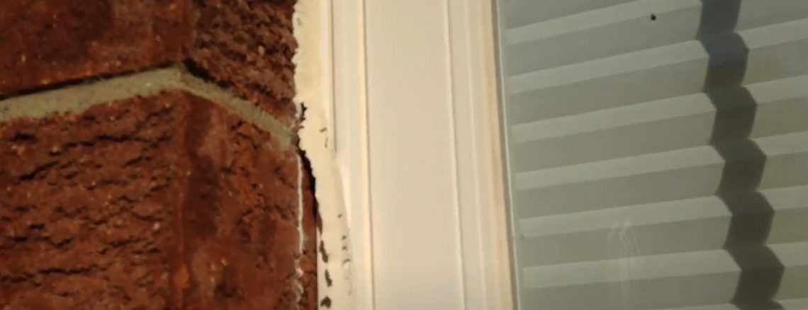 removing-caulk-from-around-window-frame