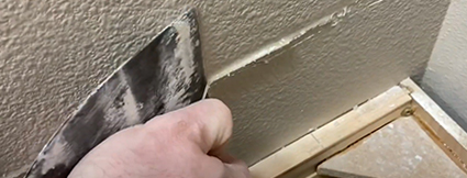 using-a-puppy-knife-to-remove-dry-caulk